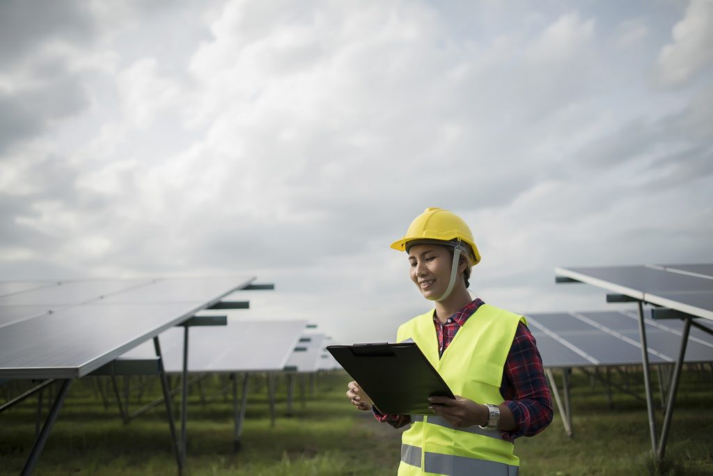 Engineer electric woman checking and maintenance of solar cells